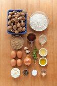 Ingredients for unripe spelt grain tagliatelle with mushroom sauce