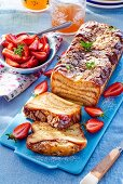 Pain perdu terrine made with brioche and served with strawberries
