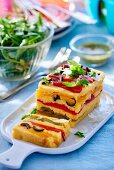 Polenta terrine with red pepper and olives