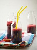 Blueberry and beetroot smoothies in bottles