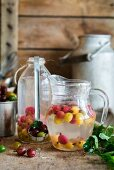 Russian hot drink kompot made from gooseberries, water and sugar