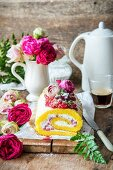 A rose water sponge roll with wild strawberries and whipped cream
