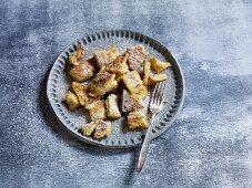 'Kaiserschmarrn' (fluffy shredded pancake) with icing sugar