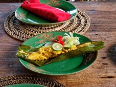 Fish in banana leaf with ligth curry, Lombok island, Indonesia