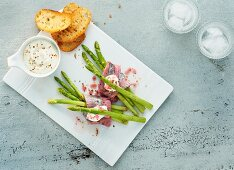 Green asparagus with sherry soaked herring and toasted bread slices