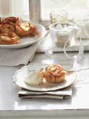 Puff pastry apple roses with whipped cream