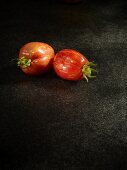 Two orange Tiger tomatoes