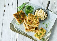 Foccacia on a tray with salted butter and bear's garlic pesto