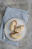 Bruschetta with bananas, peanut butter and almond flakes
