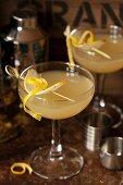 Cardamom spiced pear Martini with pear and lemon garnish