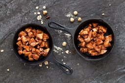 Chopped pears Melted Chocolate in cast iron skillets