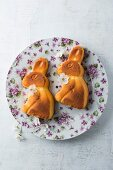 Two cakes shaped like Easter bunnies on a dish