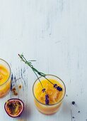 Peach and lavender cooler with sparkling water and passion fruit