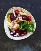 A beetroot, spinach, peach and strawberry salad (Lebanon)