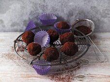 Black bean truffle pralines with sweet lupin flour