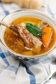 Soup with pork and orange pepper (Asia)