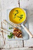Pumpkin soup with saté skewers