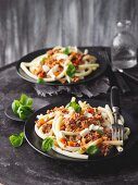 Macaroni with red pepper and minced beef sauce