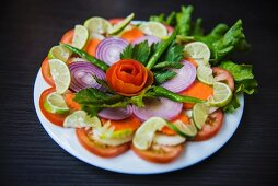 Mixed vegetable salad with tomatoes, red onions and limes