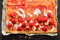 Sweet raspberry pizza with mascarpone and almond flakes