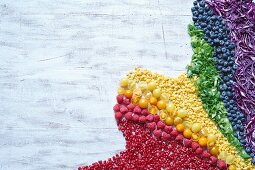 Fruit, herbs and vegetables in rainbow colours