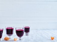An autumnal beetroot juice with mandarin orange, apple and ginger