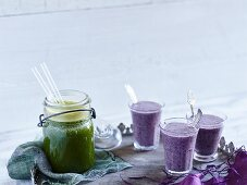 Goutweed and apple smoothie and a purple blueberry oat drink