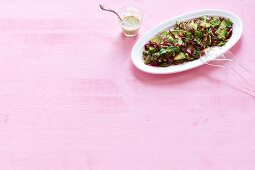 Raw broccoli and avocado salad with beetroot