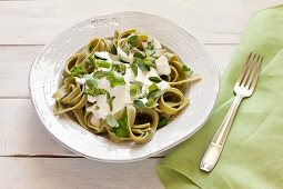 Gluten-free spinach fettuccine with cottage cheese sauce
