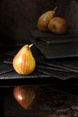 A pear reflected in water