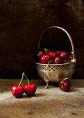 Fresh cherries in a vintage bowl