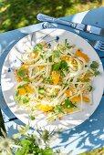 Summery kohlrabi salad with apple, fennel, orange and hazelnuts