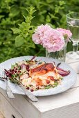 Baked cod with harissa crust on a bed of rice with pomegranate seeds