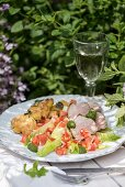 Pork loin with chimichurri, potatoes and criolla salad