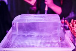 Large block of ice about to be carved for cocktails at a night club