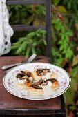 Blinis (Russian pancakes made from buckwheat flour) served with feta and wild mushrooms
