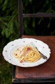 Spaghetti carbonara (pasta with smoked bacon, parmesan and egg yolk)