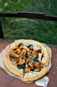 A puff pastry tart with spinach, gorgonzola and chanterelle mushrooms