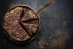 Homemade chocolate cake served on metal plate