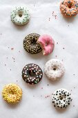 Mini American donuts splashed on the white background