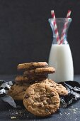 Sweet homemade chip cookies and bottle of milk, selective focus