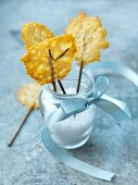 Parmesan lollipops in a glass