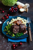 Cranberry roulades with spelt spaetzle and savoy cabbage