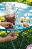 Peach and honey iced tea with ice sticks