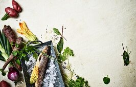 Ingredients for a clean eating recipe (fish, vegetables and herbs)