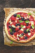 A sweet berry pizza with mozzarella