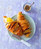 Chocolate croissants with butter and passion fruit jam