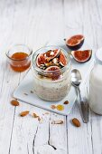 Overnight oats with figs and honey in a glass
