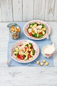 Caesar salad with chicken breast, avocado and cherry tomatoes