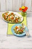 A lentil salad with green lentils, carrots, avocado and feta